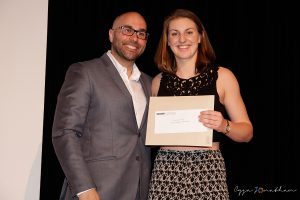 Geneviève Guay (right) accepts the award from Phys-Ed teacher Mark Longpré
