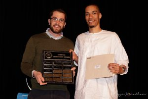 Ibrahim Ngom (right) accepts the award from Phys-Ed teacher Greg Longtin
