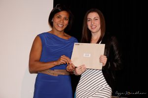 Caroline Task (right) accepts the award from Coach Ruby Viray