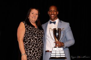 Brian Harelimana (right) accepts the award from Student Life Coordinator Mireille Béland